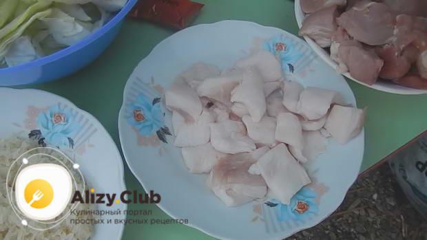 Рецепт капусты с мясом и рисом в казане на костре